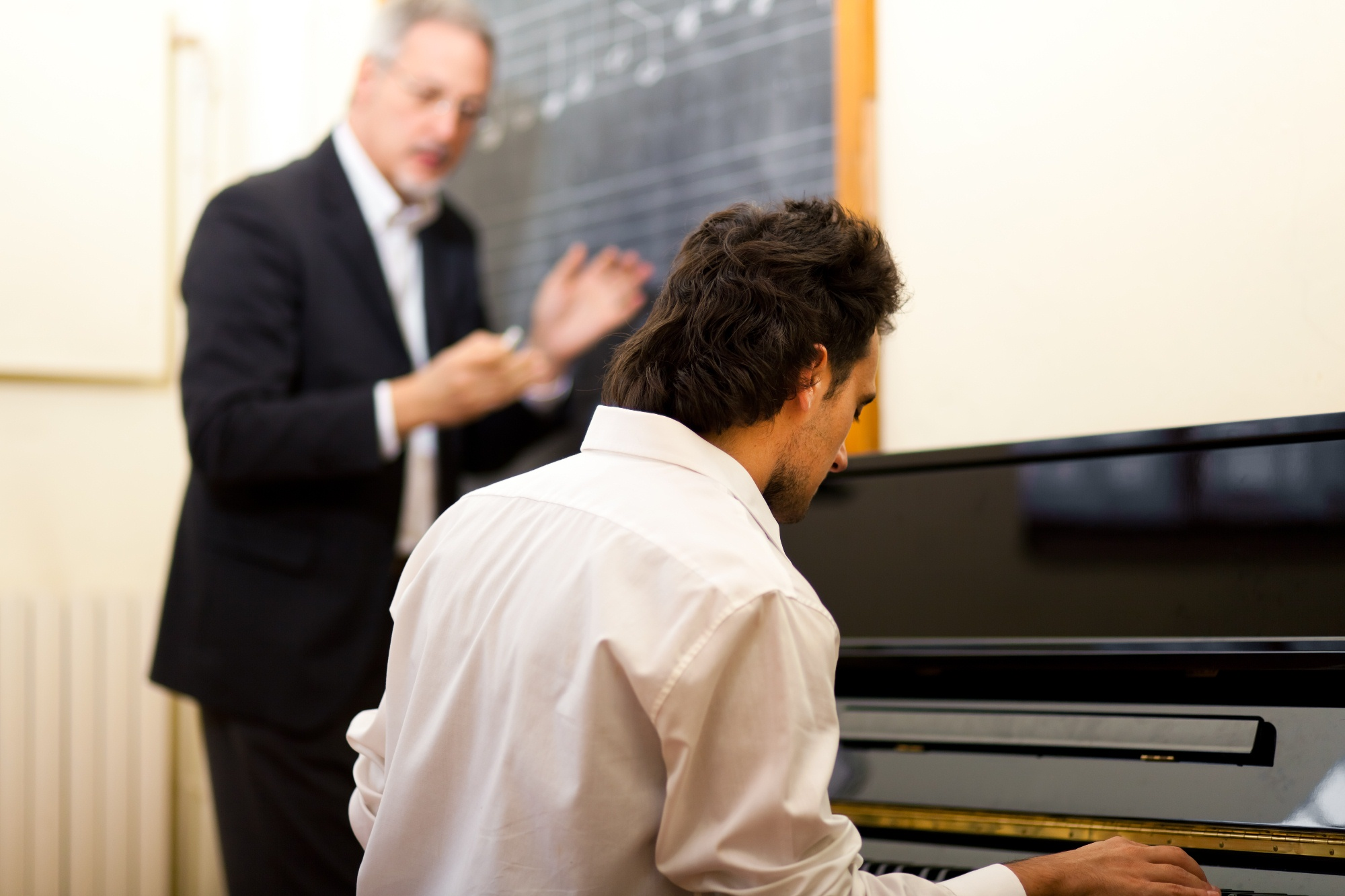 A pianist learning from a teacher