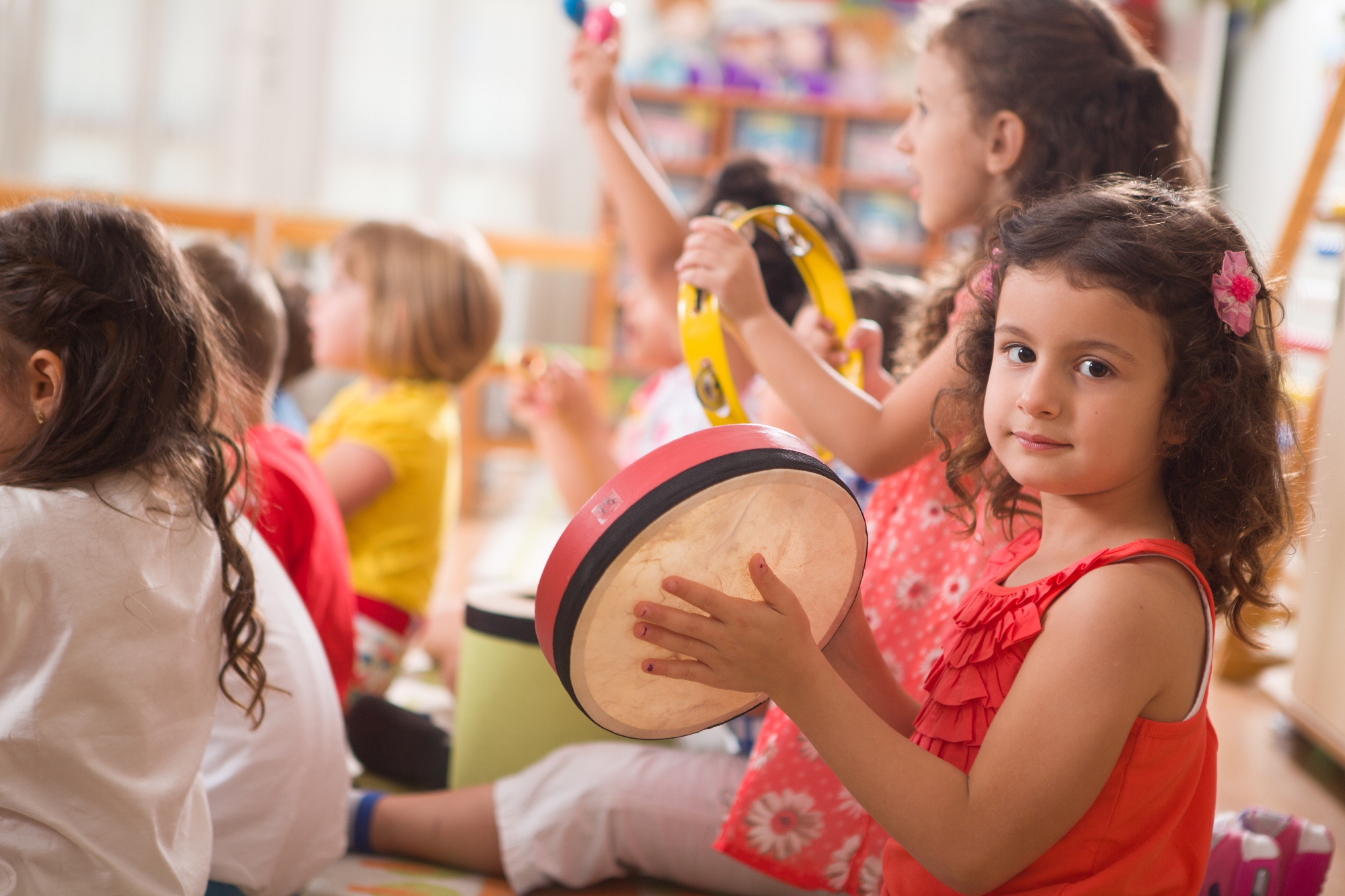 Early childhood music kids having fun with instruments