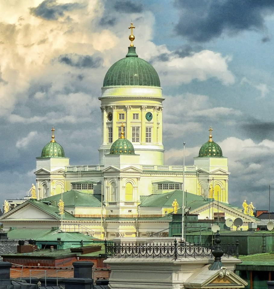 Helsinki Cathedral against a dramatic blue and cloudy sky
