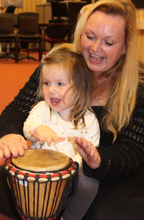 Mother and child on djembe