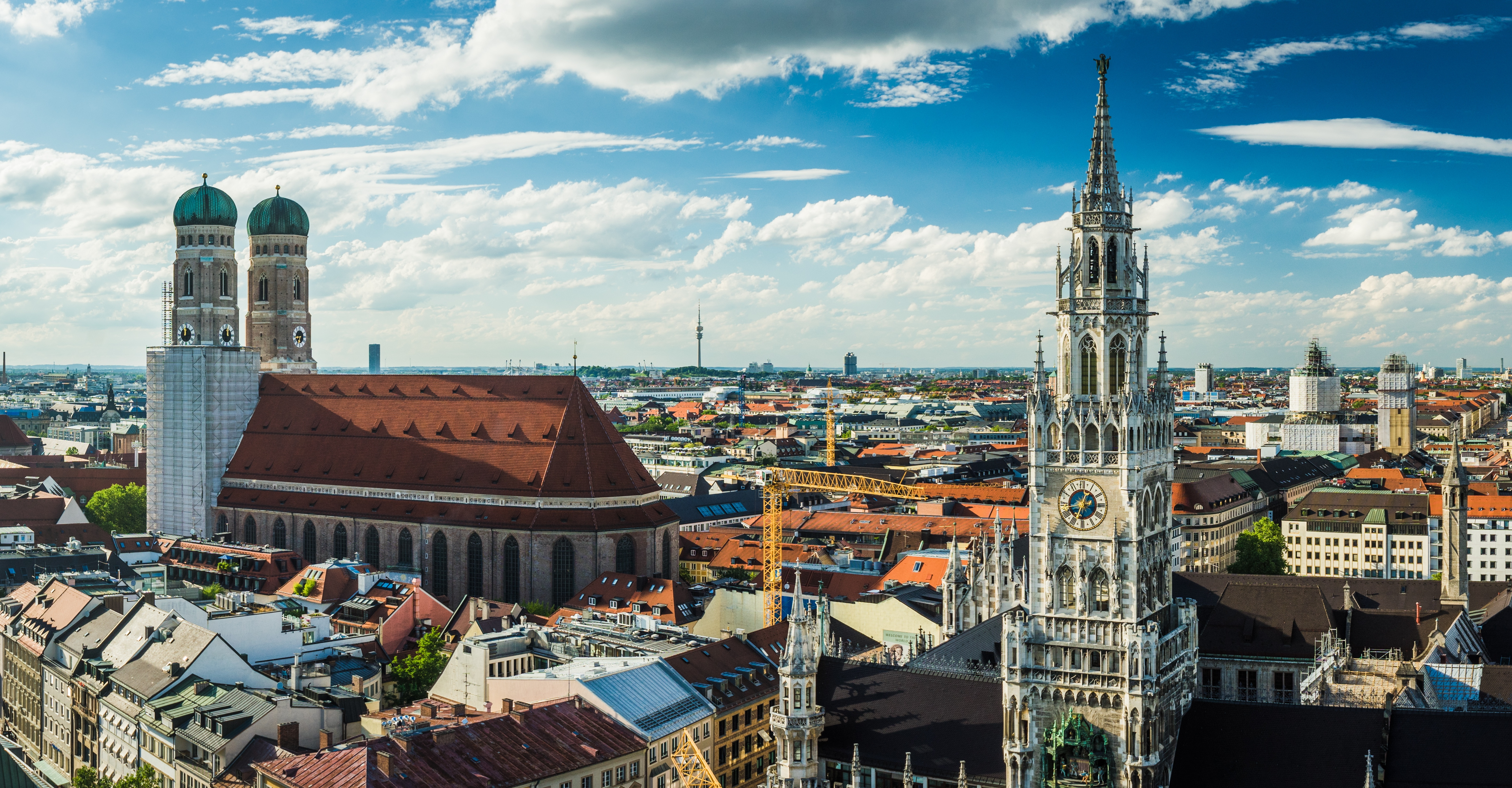 View over roofs in Munich. Churches, red roof tiles.