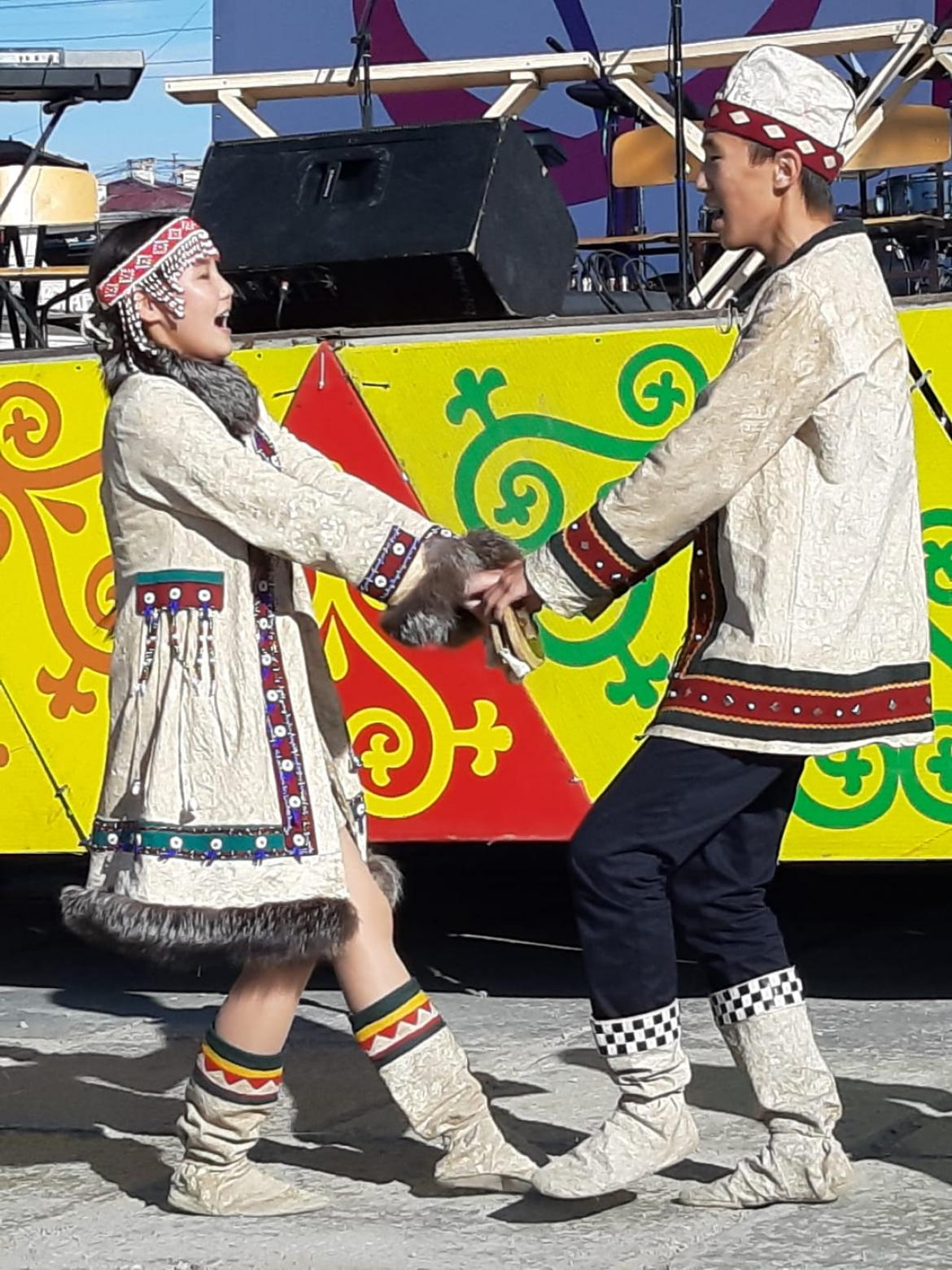 Two children in local costume in Yakutsk singing and dancing
