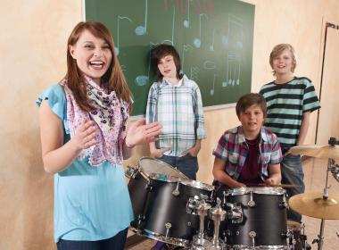 Classroom music teacher with kids in a class