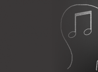A head with music notes in it, drawn on a blackboard